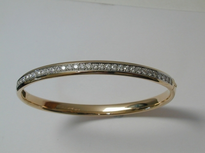 18ct and platinum hinged diamond bangle