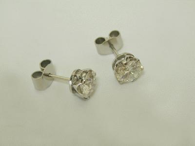 Claw set round diamond studs