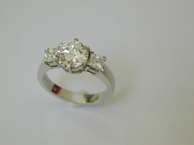 round and square three stone diamond ring