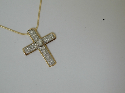 Diamond cross in 18ct yellow and white gold