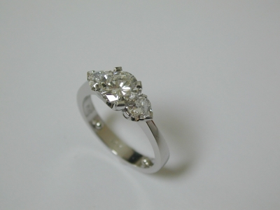 Round and heart shaped three stone diamond ring
