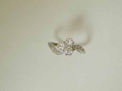 Three stone platinum flower ring.