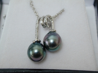 Twin pearl and diamond pendant